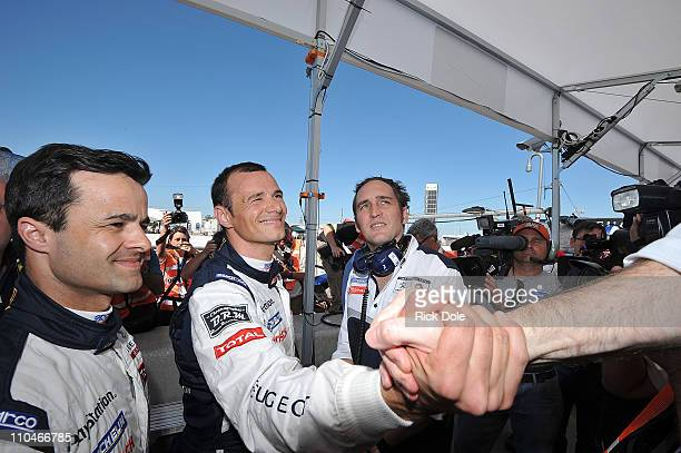 Stephane Sarrazin of France, receives congratulations after qualifying on pole position in the Peugeot Sport Total Peugeot 908 during qualifying for...