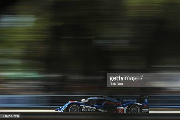 Stephane Sarrazine of France drives the Peugeot Sport Total Peugeot 908 during practice for the Intercontinental Le Mans Cup 12 Hours of Sebring at...