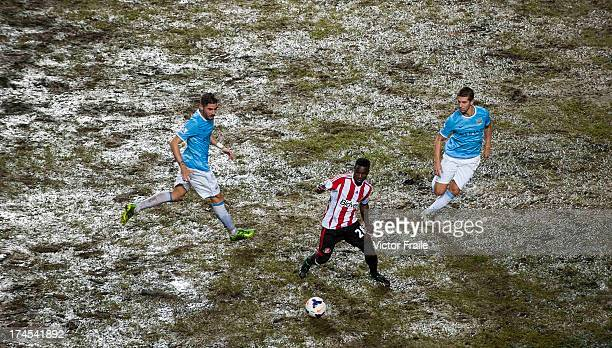 Stephane Sessegnon of Sunderland AFC controls the ball ahead of Javi Garcia and Matija Nastasic of Mancester City FC during the Barclays Asia Trophy...