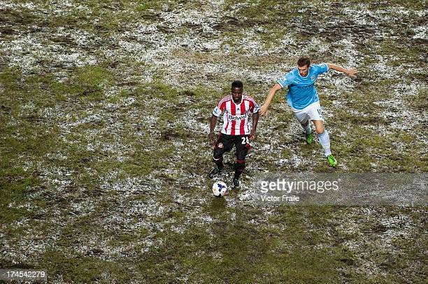 Stephane Sessegnon of Sunderland and Edin Dzeko Manchester City compete for the ball during the Barclays Asia Trophy Final match between Manchester...