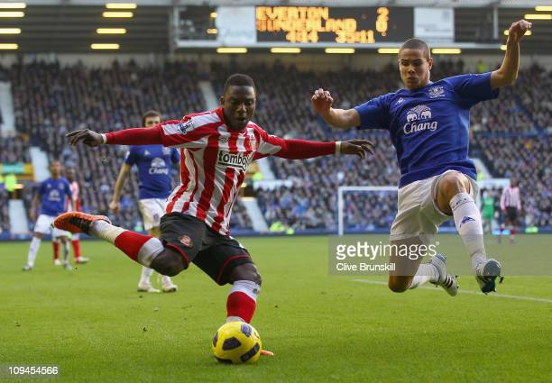 Stephane Sessegnon of Sunderland attempts to cross the ball before a flying challenge by Jack Rodwell of Everton during the Barclays Premier League...
