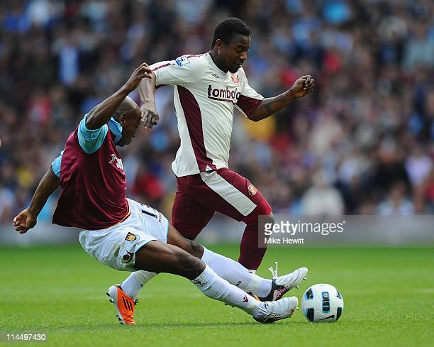 Stephane Sessegnon of Sunderland is tackled by Luis Boa Morte of West Ham during the Barclays Premier League match between West Ham United and...