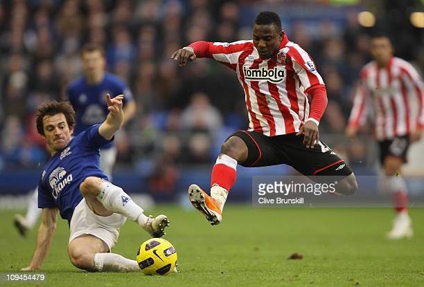 Stephane Sessegnon of Sunderland leaps into a challenge for the ball with Leighton Baines of Everton during the Barclays Premier League match between...