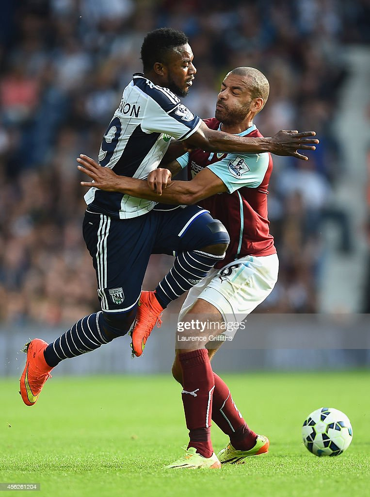 Stephane Sessegnon of West Brom collides with Steven Reid of Burnley during the Barclays Premier League match between West Bromwich Albion and Burnley at The Hawthorns on September 28, 2014 in West Bromwich, England.