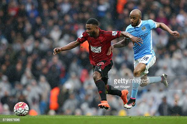 Stephane Sessegnon of West Bromwich Albion and Fabian Delph of Manchester City compete for the ball during the Barclays Premier League match between...