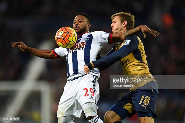 Stephane Sessegnon of West Bromwich Albion and Nacho Monreal of Arsenal compete for the ball during the Barclays Premier League match between West...