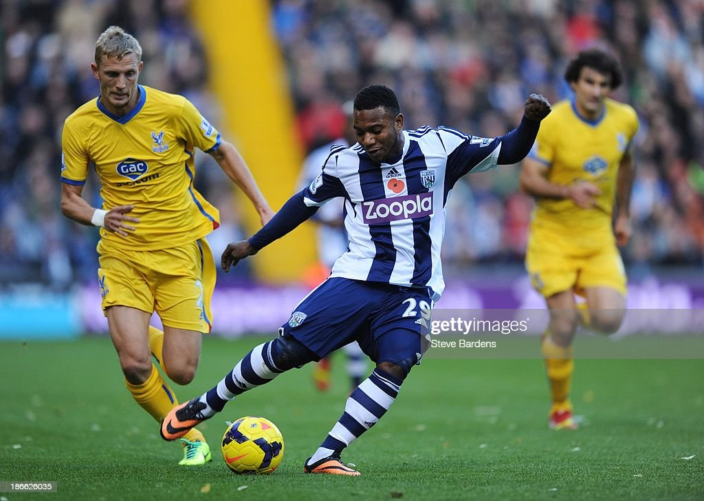 Stephane Sessegnon of West Bromwich Albion breaks away from the challenge of Joel Ward (L) of Crystal Palace during the Barclays Premier League match between West Bromwich Albion and Crystal Palace at The Hawthorns on November 2, 2013 in West Bromwich, England.
