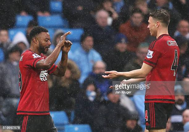 Stephane Sessegnon of West Bromwich Albion celebrates scoring his team's first goal with his team mate James Chester during the Barclays Premier...