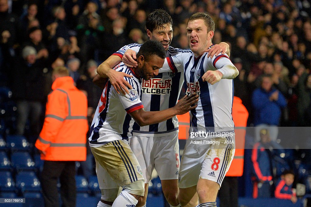 Stephane Sessegnon of West Bromwich Albion celebrates with Claudio Yacob and Craig Gardner of West Bromwich Albion after scoring a goal to make it 1-0 during the Barclays Premier League match between West Bromwich Albion and Stoke City at The Hawthorns on January 02, 2016 in West Bromwich, England.