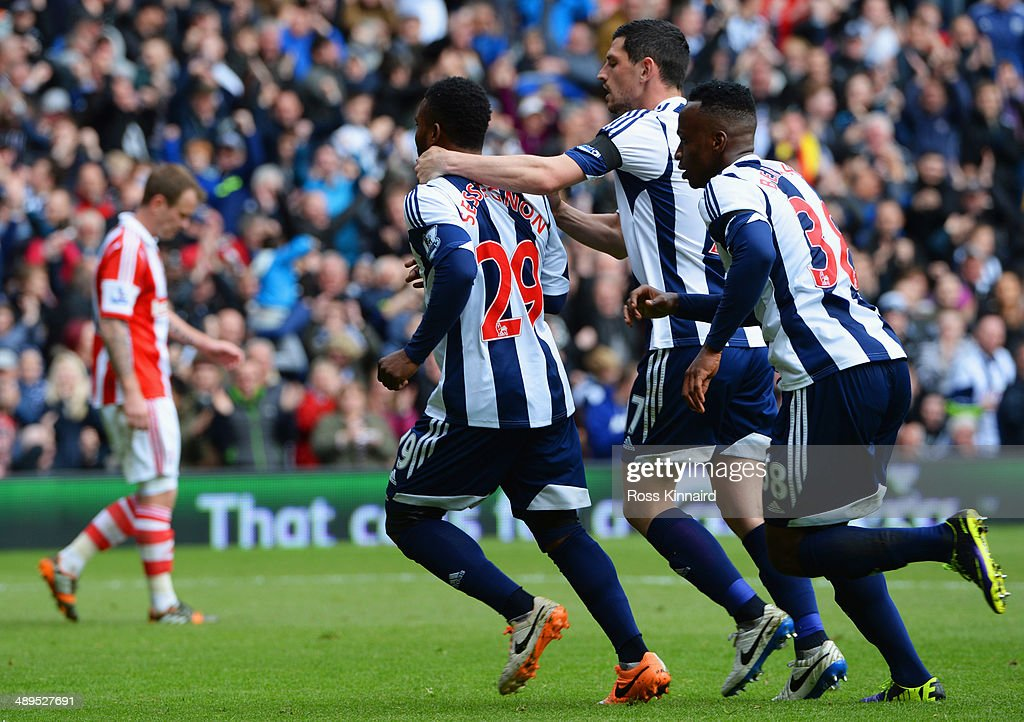 Stephane Sessegnon of West Bromwich Albion (29) celebrates with Graham Dorrans (2R) and Saido Berahino (R) as he scores their first goal during the Barclays Premier League match between West Bromwich Albion and Stoke City at The Hawthorns on May 11, 2014 in West Bromwich, England.