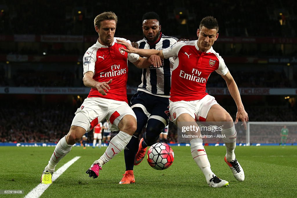 Stephane Sessegnon of West Bromwich Albion competes with Nacho Monreal and Laurent Koscielny of Arsenal during the Barclays Premier League match between Arsenal and West Bromwich Albion at the Emirates Stadium, on April 21, 2016 in London, England.