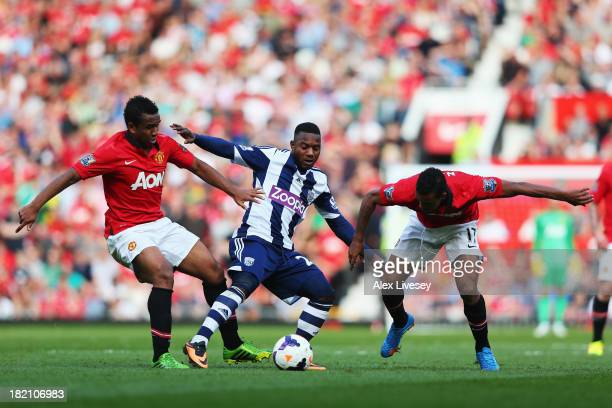 Stephane Sessegnon of West Bromwich Albion holds off Anderson and Nani of Manchester United during the Barclays Premier League match between...