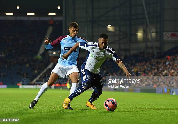Stephane Sessegnon of West Bromwich Albion holds off Andrai Jones of Gateshead during the FA Cup Third Round match between West Bromwich Albion and...