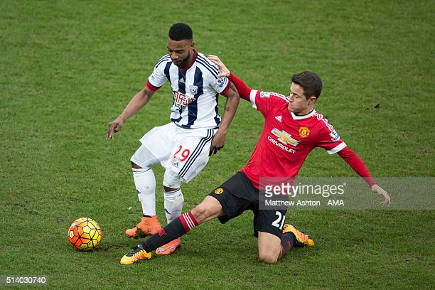 Stephane Sessegnon of West Bromwich Albion is tackled by Ander Herrera of Manchester United during the Barclays Premier League match between West...
