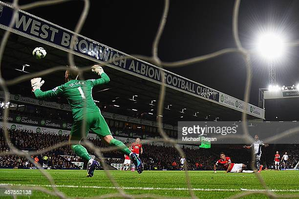 Stephane Sessegnon of West Bromwich Albion shoots past goalkeeper David De Gea of Manchester United to score their first goal during the Barclays...