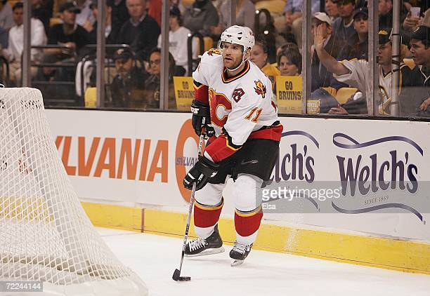 Stephane Yelle of the Calgary Flames looks to make a play from behind the net against the Boston Bruins on October 19 2006 at TD Banknorth Garden in...