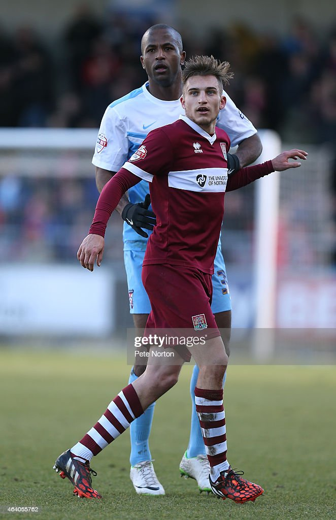 Stephane Zubar of York City looks on with Lawson D'Ath of Northampton Town during the Sky Bet League Two match between Northampton Town and York City at Sixfields Stadium on February 21, 2015 in Northampton, England.