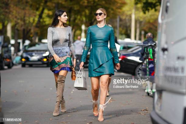 Stephanie Abrishamchi wears a gray flitter mesh dress with colored ruffles brown suede high boots Farnoush Hamidian wears a green leather dress a bag...