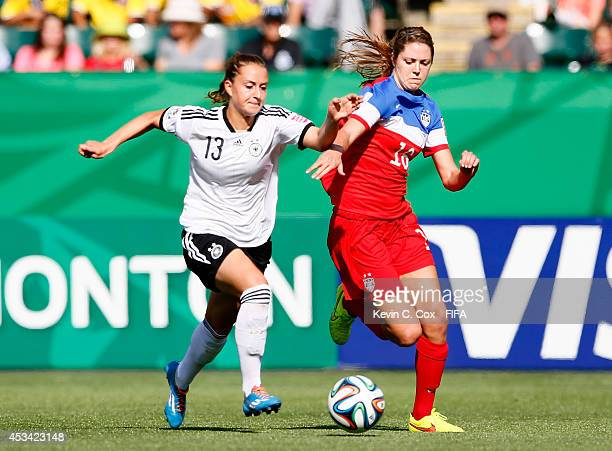 Stephanie Amack of the United States in action against Sara Daebritz of Germany during the FIFA U20 Women's World Cup Canada 2014 Group B match...