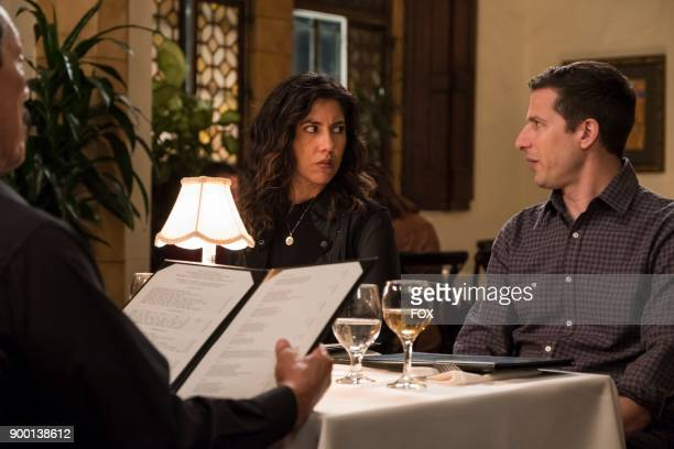 Stephanie Beatriz and Andy Samberg in the Game Night Godfather special one hour episode of BROOKLYN NINENINE airing Tuesday Dec 12 on FOX