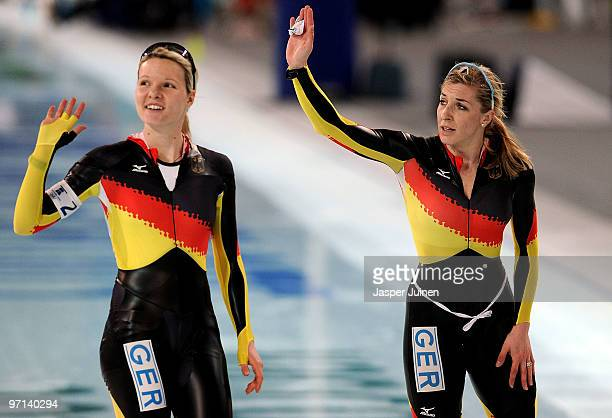Stephanie Beckert and Anna FriesingerPostma of Germany wave after the ladies' team pursuit semifinals on day 16 of the 2010 Vancouver Winter Olympics...