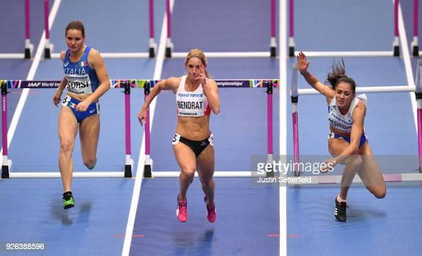 Stephanie Bendrat of Austria and Veronica Borsi of Italy compete as Elisavet Pesiridou of Greece falls during the 60 Metres Hurdles Womens Round 1...