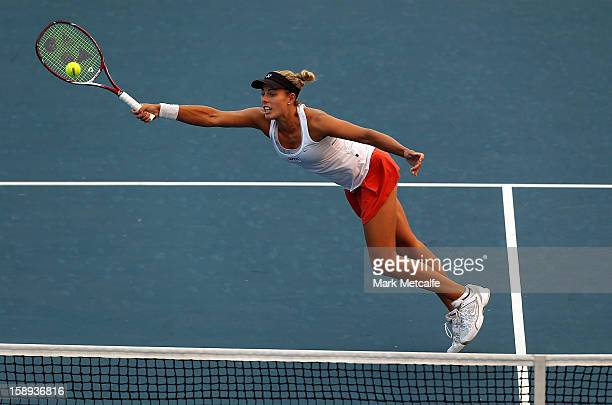 Stephanie Bengson of Australia plays a forehand volley in her qualifying singles match with Sacha Jones of Australia during day one of the Hobart...