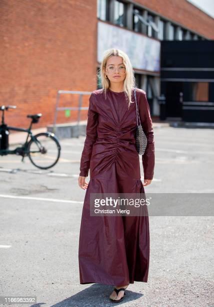 Stephanie Broek is seen wearing bordeaux leather dress outside By Malene Birger during Copenhagen Fashion Week Spring/Summer 2020 on August 08, 2019...