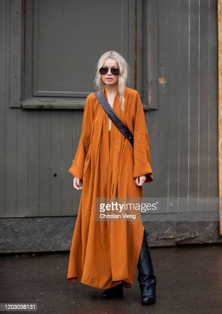 Stephanie Broek seen wearing orange dress outside Rodebjer during Copenhagen Fashion Week Autumn/Winter 2020 Day 3 on January 30 2020 in Copenhagen...