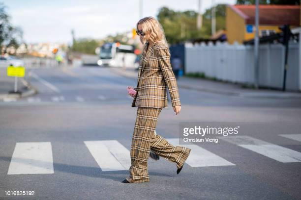 Stephanie Broek wearing beige brown checked suit seen outside byTiMo during Oslo Runway SS19 on August 14 2018 in Oslo Norway