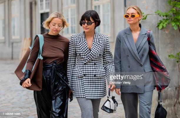 Stephanie Broek wearing black high waist pleated skirt brown long shirt Maria Bernad is seen wearing black white plaid blazer two tone bag pants and...