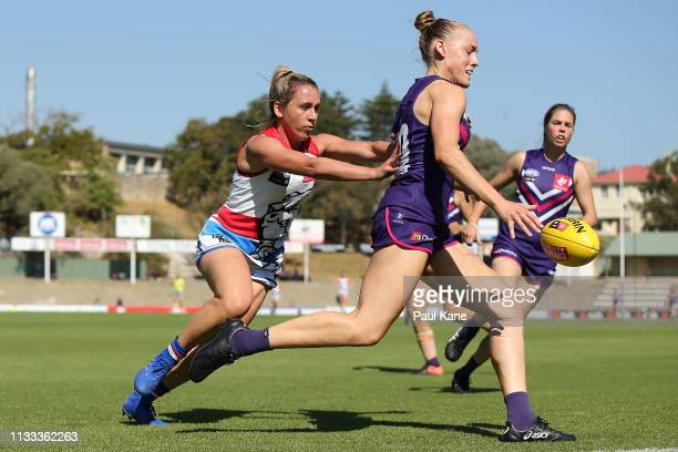 Stephanie Cain of the Dockers gets her kick away under pressure during the round five AFLW match between the Fremantle Dockers and the Western...