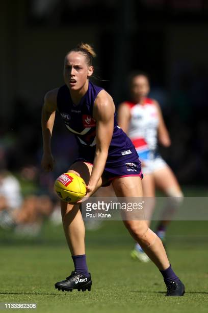 Stephanie Cain of the Dockers looks to handball during the round five AFLW match between the Fremantle Dockers and the Western Bulldogs at Fremantle...