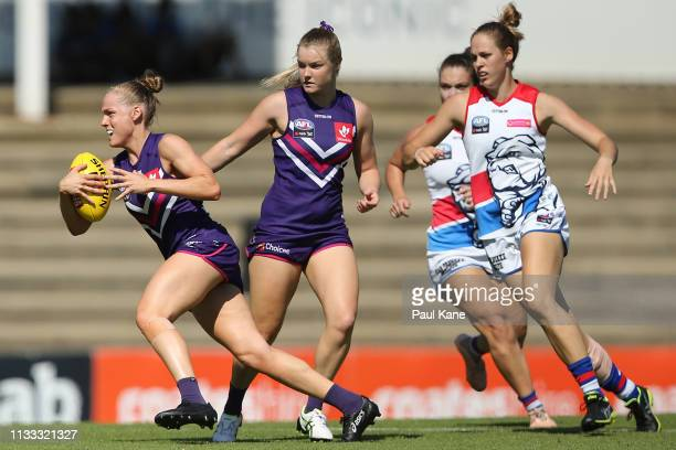 Stephanie Cain of the Dockers runs with the ball during the round five AFLW match between the Fremantle Dockers and the Western Bulldogs at Fremantle...