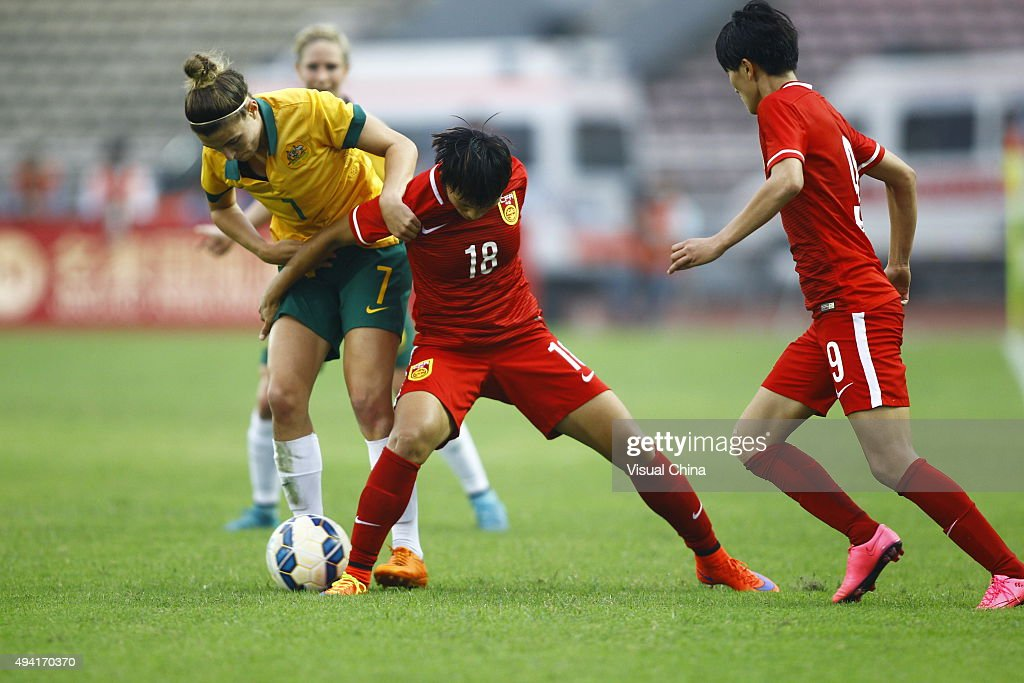 Stephanie Catley #7 of Australia and Han Peng #18 of China compete for the ball in the match between China and Australia during the 2015 Yongchuan Women's Football International Matches at Yongchuan Sports Center on October 25, 2015 in Yongchuan, Chongqing of China.