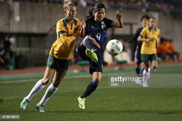 Stephanie Catley of Australia and Kawasumi Nahomi of Japan compete for the ball during the AFC Women's Olympic Final Qualification Round match...