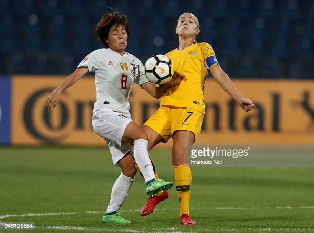 Stephanie Catley of Australia and Mana Iwabuchi of Japan in action during the AFC Women's Asian Cup final between Japan and Australia at the Amman...