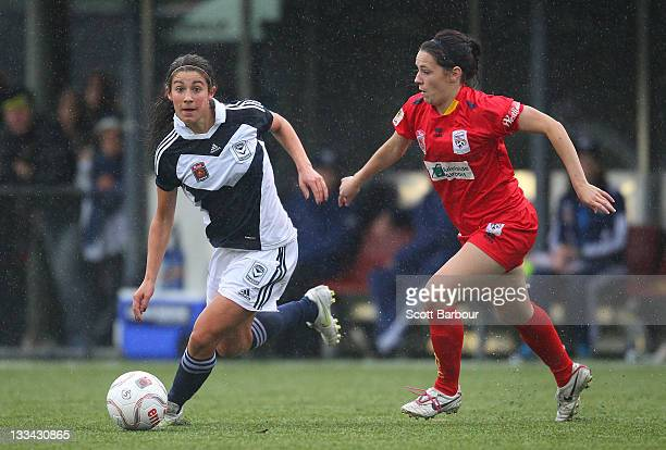 Stephanie Catley of the Victory and Donna Cockayne of United compete for the ball during the round five WLeague between the Melbourne Victory and...