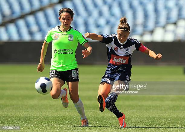 Stephanie Catley of the Victory gets a pass away under pressure from Ashleigh Sykes of United during the WLeague Semi Final match between Melbourne...