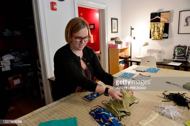 Stephanie Cave sews the mask seems and straps together to finish creating masks at Stitch House on March 22 2020 in Dorchester Massachusetts From...
