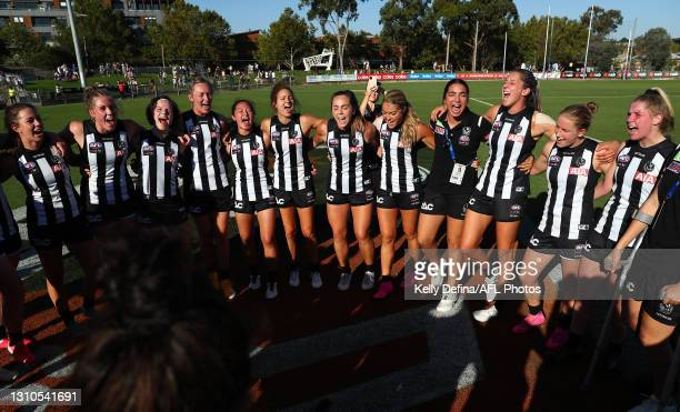 Stephanie Chiocci of the Magpies and team mates celebrate the victory during the AFLW Finals Series match between the Collingwood Magpies and the...