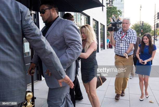 Stephanie Clifford also known as adult film star and director Stormy Daniels arrives for her first night of her twonight appearance surrounded by...