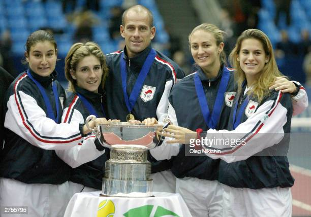 Stephanie CohenAloro Emilie Loit coach Guy Forget Mary Pierce and Amelie Mauresmo of France hold their trophy after winning the 41st Fed Cup November...