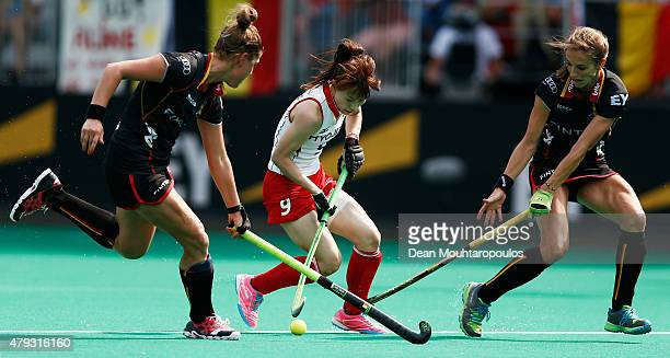 Stephanie De Groof and Judith Vandermeiren of Belgium battle for the ball with Mie Nakashima of Japan during the 5th to 8th place match between...