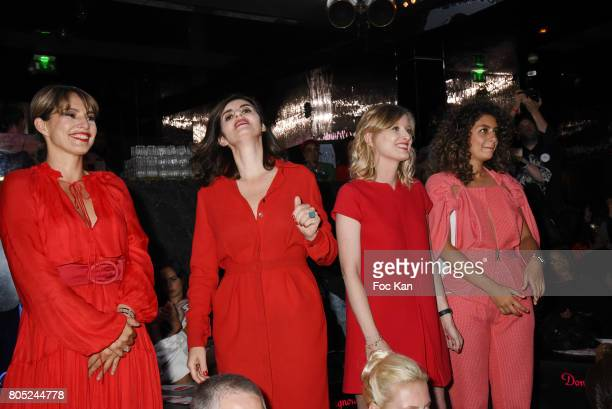 Stephanie de Muru, Sandrine Sarroche, Karine De Menonville and Anne Valerie Payet attend the 'Red Defile' Auction Fashion Show Hosted by Ajila...