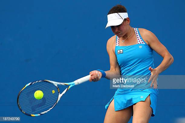 Stephanie Dubois of Canada plays a forehand in her first round match against Elena Vesnina of Russia during day two of the 2012 Australian Open at...