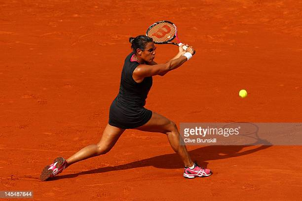 Stephanie Foretz Gacon of France plays a backhand in her women's singles second round match against Na Li of China during day 5 of the French Open at...