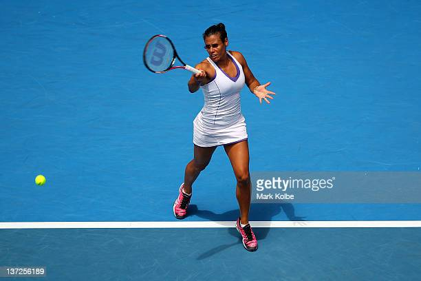 Stephanie Foretz Gacon of France plays a forehand in her second round match against Kim Clijsters of Belgium during day three of the 2012 Australian...
