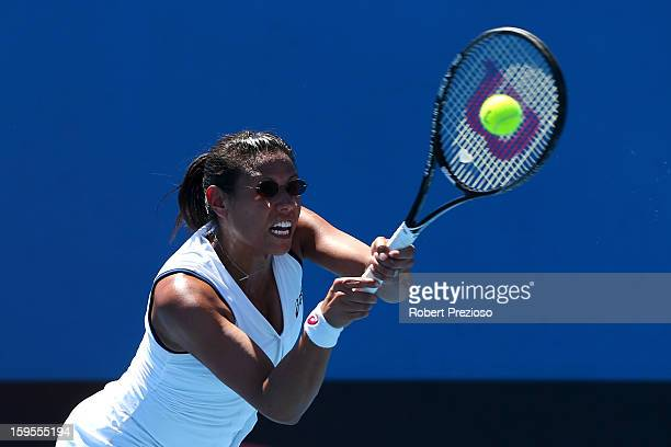 Stephanie Foretz Gacon of France plays a forehand in her second round match against Ekaterina Makarova of Russia during day three of the 2013...