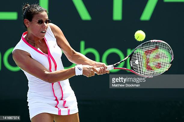 Stephanie Foretz Gacon of France returns a shot to Olivia Rogowska of Australia during the Sony Ericsson Open at the Crandon Park Tennis Center on...